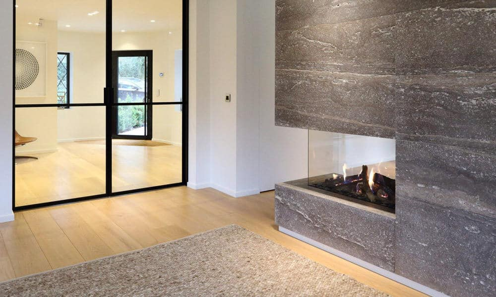 living room natural stone travertine fireplace